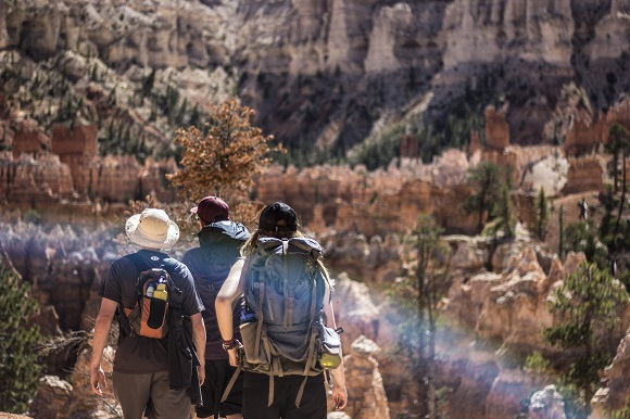 Three travelers hiking