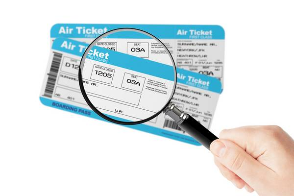 magnifying lense air ticket flight
