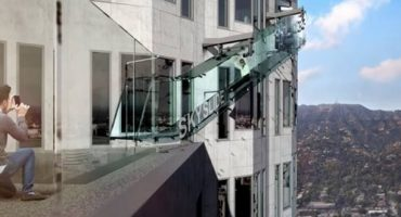 View Los Angeles from the 70th floor of a skyscraper whilst gliding down a glass slide