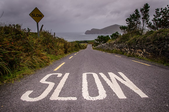 Slow travel road sign