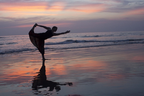 Yoga on the beach in Kerala, India