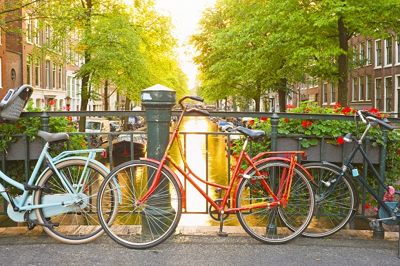 Bikes by Amsterdam canal Netherlands