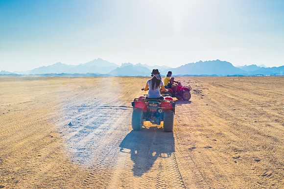 Quad bike riders in the Sahara Desert