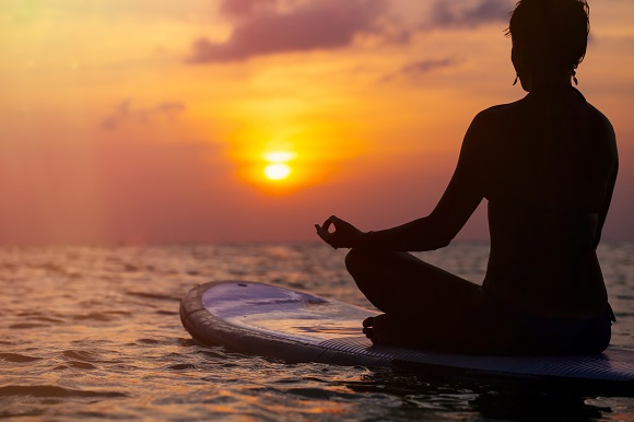 Paddleboard yoga at sunset
